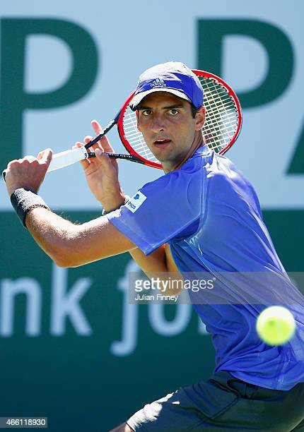 Thomaz Bellucci of Brazil in action against Simone Bolelli of Italy during day five of the BNP Paribas Open tennis at the Indian Wells Tennis Garden...