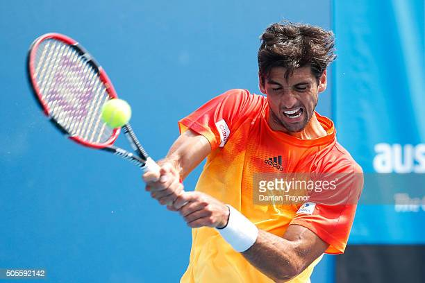 Thomaz Bellucci of Brazil plays a backhand in his first round match against Jordan Thompson of Australia during day two of the 2016 Australian Open...