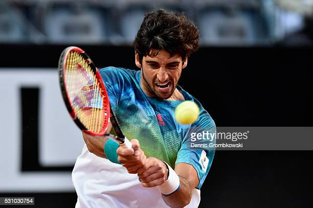 Thomaz Bellucci of Brazil plays a backhand in his match against Novak Djokovic of Serbia on Day Five of The Internazionali BNL d'Italia on May 12...