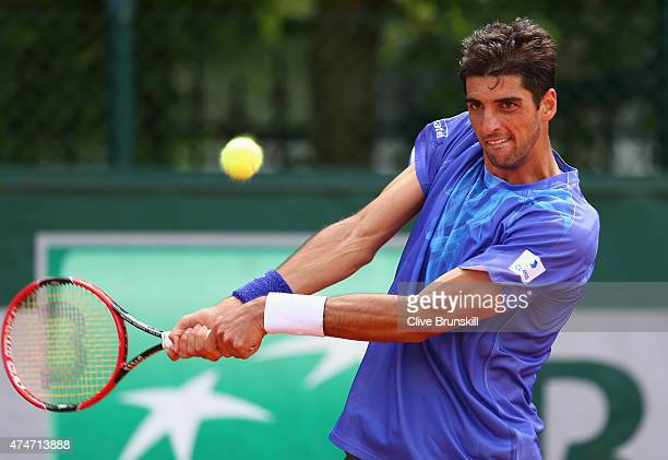 Thomaz Bellucci of Brazil plays a backhand in his Men's Singles match against Marinko Matosevic of Australia on day two of the 2015 French Open at...