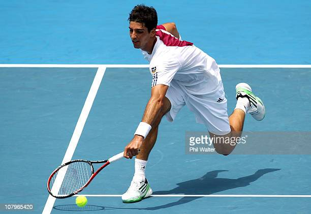 Thomaz Bellucci of Brazil plays a forehand during his match against Michael Russell of the USA on day two of the Heineken Open at ASB Tennis Centre...