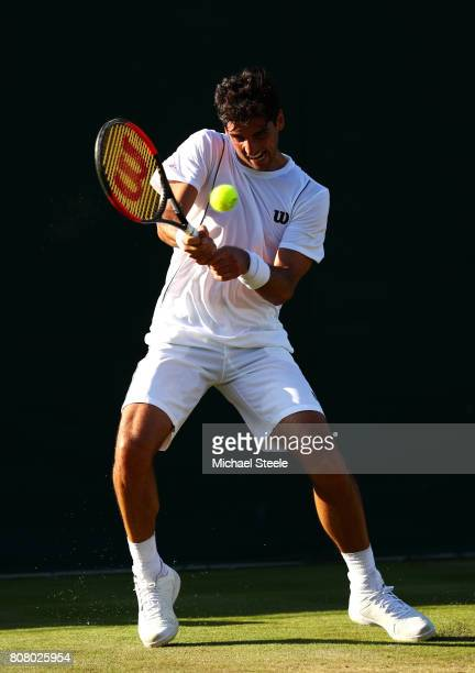 Thomaz Bellucci of Brazil plays a forehand during the Gentlemen's Singles first round match against Sebastian Ofner of Austria on day two of the...