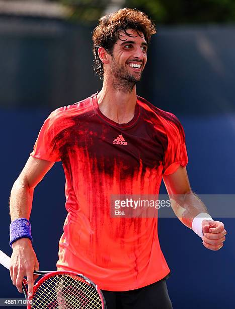 Thomaz Bellucci of Brazil reacts after defeating James Ward of Great Britain during his Men's Singles First Round match on Day Two of the 2015 US...