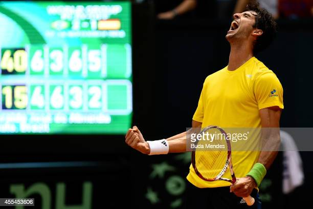 Thomaz Bellucci of Brazil reacts after winning his playoff singles match against Roberto Bautista Agut of Spain on the World Group Playoff round of...