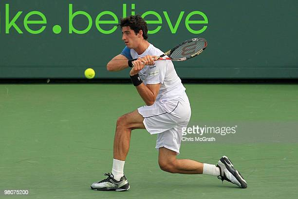 Thomaz Bellucci of Brazil returns a shot against James Blake of the United States during day four of the 2010 Sony Ericsson Open at Crandon Park...