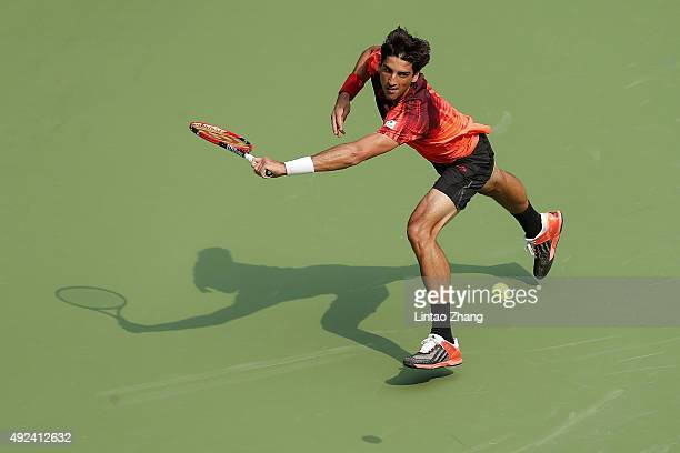 Thomaz Bellucci of Brazil returns a shot against Milos Raonic of Canada during their men's singles first round match on day 3 of Shanghai Rolex...