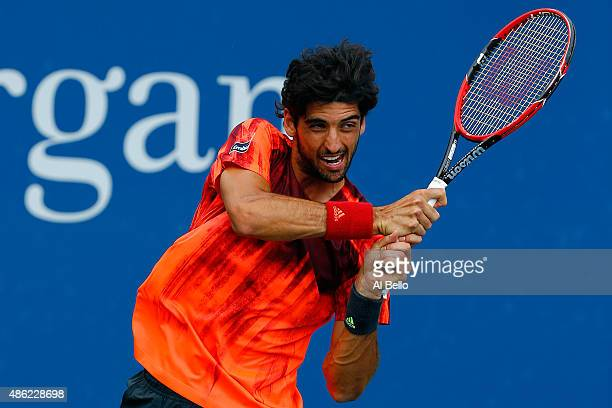 Thomaz Bellucci of Brazil returns a shot during his Men's Doubles First Round Match against Deiton Baughman and Tommy Paul of the USA on Day Three of...