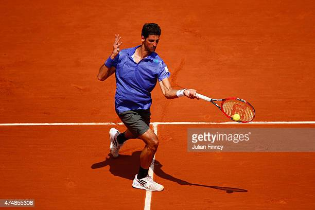 Thomaz Bellucci of Brazil returns a shot during his Men's Singles match against Kei Nishikori of Japan during day four of the 2015 French Open at...