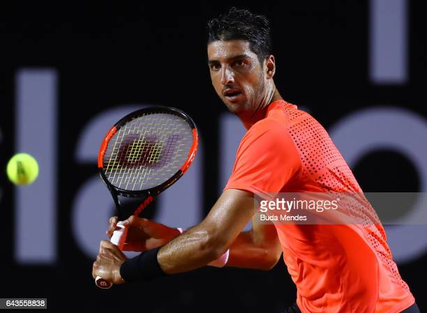Thomaz Bellucci of Brazil returns a shot to Kei Nishikori of Japan during the ATP Rio Open 2017 at Jockey Club Brasileiro on February 21 2017 in Rio...