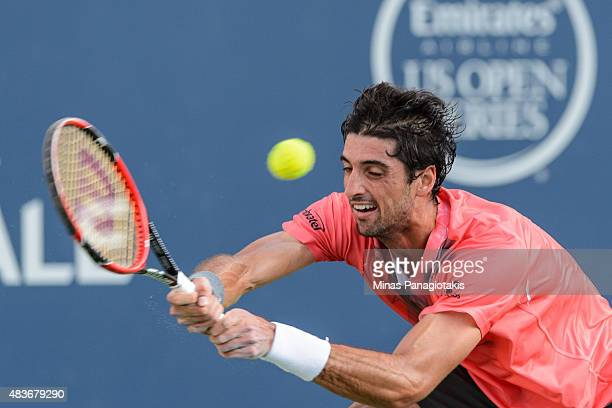Thomaz Bellucci of Brazil returns the ball against Novak Djokovic of Serbia during day two of the Rogers Cup at Uniprix Stadium on August 11 2015 in...
