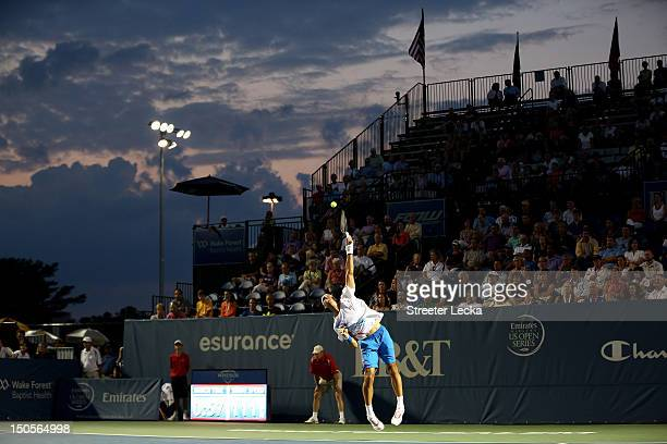 Thomaz Bellucci of Brazil serves against JoWilfried Tsonga of France during their match in the second round of the WinstonSalem Open at Wake Forest...