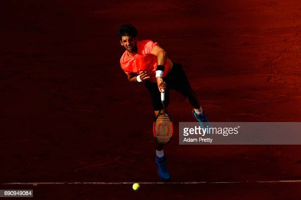 Thomaz Bellucci of Brazil serves during the mens singles second round match against Lucas Pouille of France on day four of the 2017 French Open at...