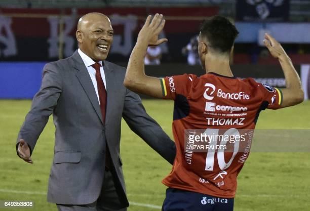 Thomaz Santos of Bolivia's Wilstermann celebrates with coach Roberto Mosquera after scoring against Uruguayan Penarol during a Copa Libertadores...