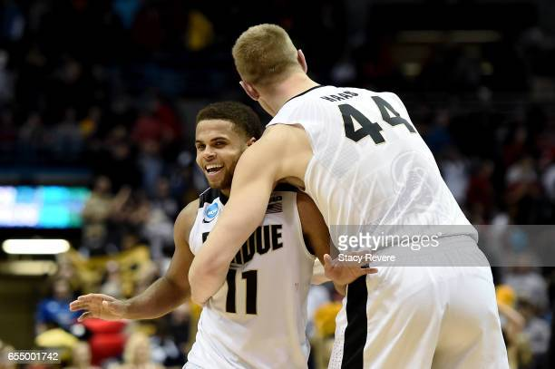 J Thompson and Isaac Haas of the Purdue Boilermakers celebrate after beating the Iowa State Cyclones 8076 during the second round of the 2017 NCAA...