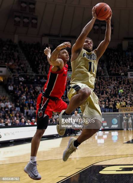 J Thompson of the Purdue Boilermakers shoots the ball as Corey Sanders of the Rutgers Scarlet Knights trails at Mackey Arena on February 14 2017 in...