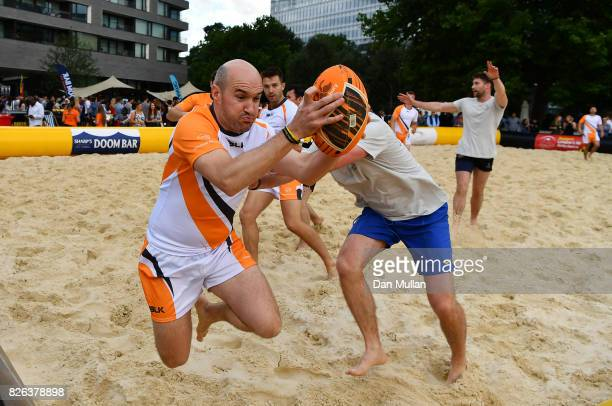 Thompson Reuters compete against Northern Trust during day one of the London Beach Rugby 2017 at Potters Field Park on August 4 2017 in London England