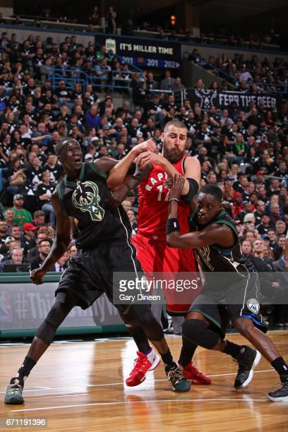 Thon Maker and Tony Snell of the Milwaukee Bucks box out Jonas Valanciunas of the Toronto Raptors during Game Three of the Eastern Conference...
