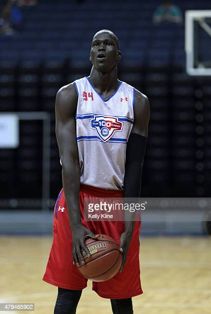 Thon Maker in white shots a free throw during the NBPA Top 100 Camp on June 18 2015 at John Paul Jones Arena in Charlottesville Virginia