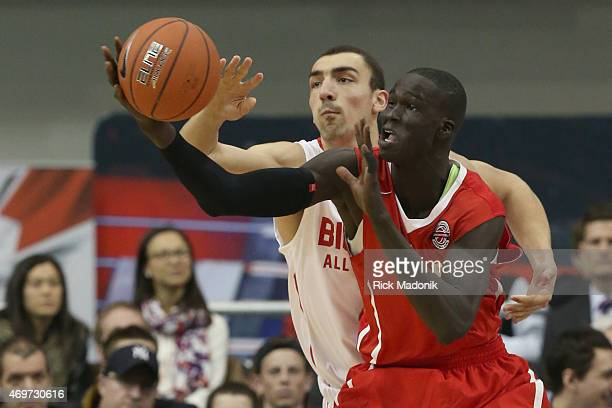 TORONTO APRIL 14 Thon Maker looks to gather the ball against the defence of Jerome Desrosiers The Biosteel All Canadian basketball game 2nd half...