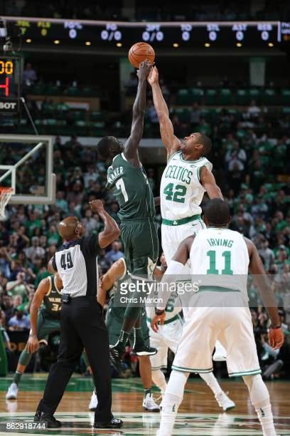 Thon Maker of the Milwaukee Bucks and Al Horford of the Boston Celtics jump for possession during the opening tipoff on October 18 2017 at the TD...