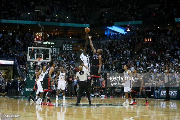 Thon Maker of the Milwaukee Bucks and Serge Ibaka of the Toronto Raptors battle for the tipoff in Game Six of the Eastern Conference Quarterfinals...