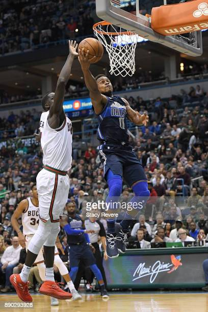 Thon Maker of the Milwaukee Bucks blocks a shot by Yogi Ferrell of the Dallas Mavericks during the second half of a game at the Bradley Center on...