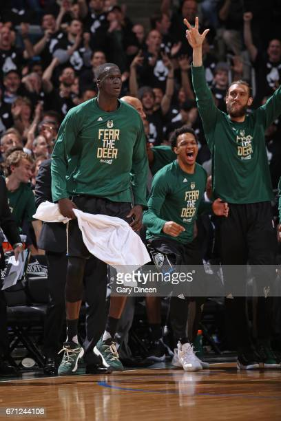 Thon Maker of the Milwaukee Bucks celebrates from the bench during Game Three of the Eastern Conference Quarterfinals against the Toronto Raptors of...
