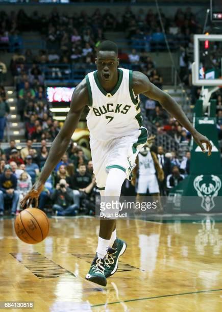 Thon Maker of the Milwaukee Bucks dribbles the ball in the first quarter against the Dallas Mavericks at BMO Harris Bradley Center on April 2 2017 in...