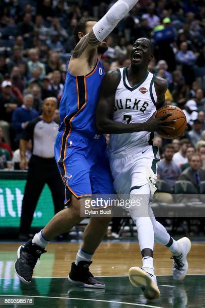 Thon Maker of the Milwaukee Bucks dribbles the ball while being guarded by Steven Adams of the Oklahoma City Thunder in the third quarter at the...