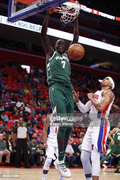 Thon Maker of the Milwaukee Bucks gets in for a dunk next to Tobias Harris of the Detroit Pistons during the first half at Little Caesars Arena on...