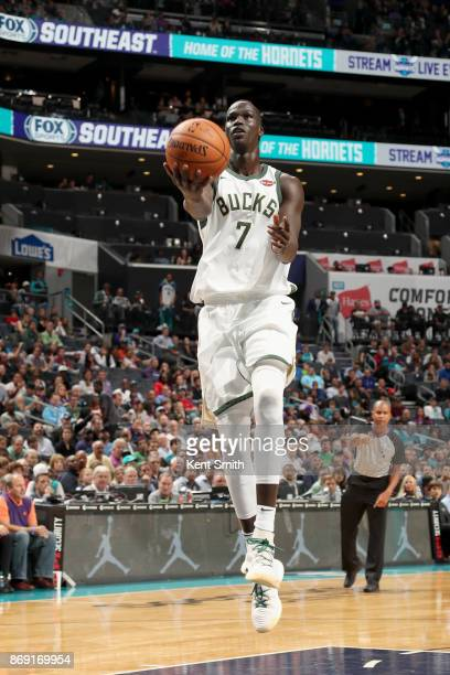 Thon Maker of the Milwaukee Bucks goes to the basket against the Charlotte Hornets on November 1 2017 at Spectrum Center in Charlotte North Carolina...