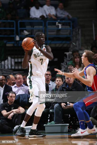 Thon Maker of the Milwaukee Bucks passes the ball against the Detroit Pistons on December 6 2017 at the BMO Harris Bradley Center in Milwaukee...