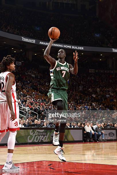 Thon Maker of the Milwaukee Bucks shoots the ball against the Toronto Raptors on December 12 2016 at the Air Canada Centre in Toronto Ontario Canada...