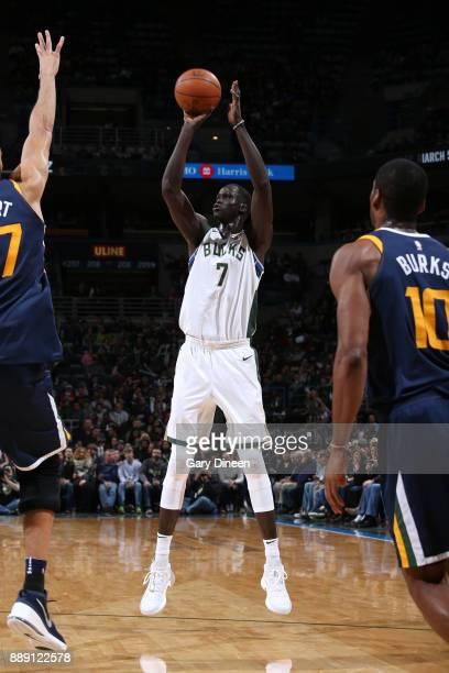 Thon Maker of the Milwaukee Bucks shoots the ball against the Utah Jazz on December 9 2017 at the BMO Harris Bradley Center in Milwaukee Wisconsin...