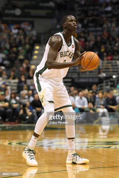 Thon Maker of the Milwaukee Bucks takes a three point shot during a game against the Charlotte Hornets at the BMO Harris Bradley Center on October 23...