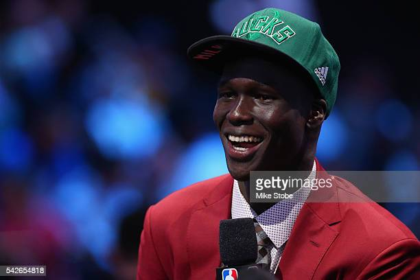 Thon Maker smiles during his interview after being drafted 10th overall by the Milwaukee Bucks in the first round of the 2016 NBA Draft at the...