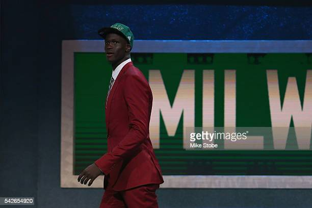 Thon Maker walks off stage after being drafted 10th overall by the Milwaukee Bucks in the first round of the 2016 NBA Draft at the Barclays Center on...