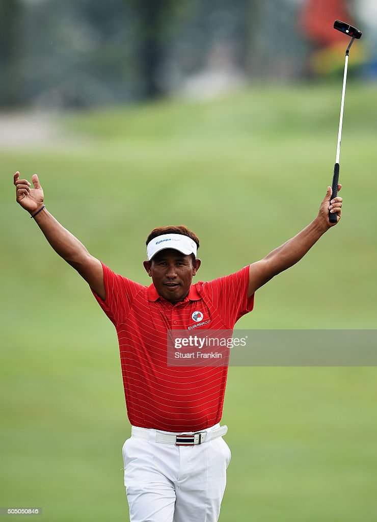 Thongchai Jaidee of team Asia celebrates a putt during the first day's fourball matches at the EurAsia Cup presented by DRBHICOM at Glenmarie GCC on...