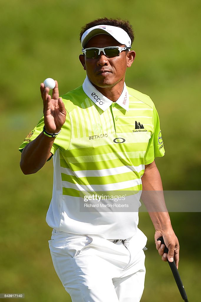 <a gi-track='captionPersonalityLinkClicked' href=/galleries/search?phrase=Thongchai+Jaidee&family=editorial&specificpeople=200733 ng-click='$event.stopPropagation()'>Thongchai Jaidee</a> of Thailand acknowledges the crowd on the 14th green during the first round of the 100th Open de France at Le Golf National on June 30, 2016 in Paris, France.