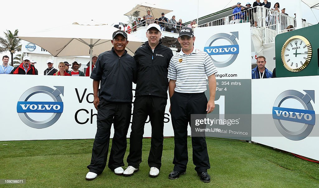 Thongchai Jaidee of Thailand, amateur, Colin Ledwith and Louis Oosthuizen of South Africa pose for a group picture on the first tee during the second round of the Volvo Golf Champions at Durban Country Club on January 11, 2013 in Durban, South Africa.