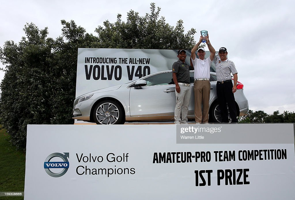 Thongchai Jaidee of Thailand, Amateur, Colin Ledworth of England and Louis Oosthuizen of South Africa pose with their prize for winning the Amateur-Pro competition after the second round of the Volvo Golf Champions at Durban Country Club on January 11, 2013 in Durban, South Africa.