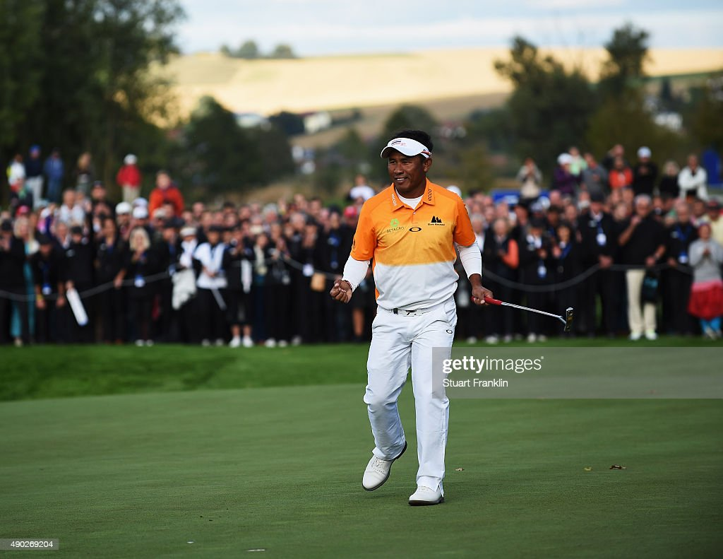 Thongchai Jaidee of Thailand celebrates holeing the winning putt on the 18th hole during the final round of the Porsche European Open at Golf Resort...