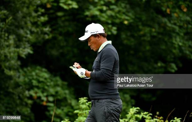 Thongchai Jaidee of Thailand checks his yardage book on hole 4 during the first round of the 146th Open Championship at Royal Birkdale on July 20...