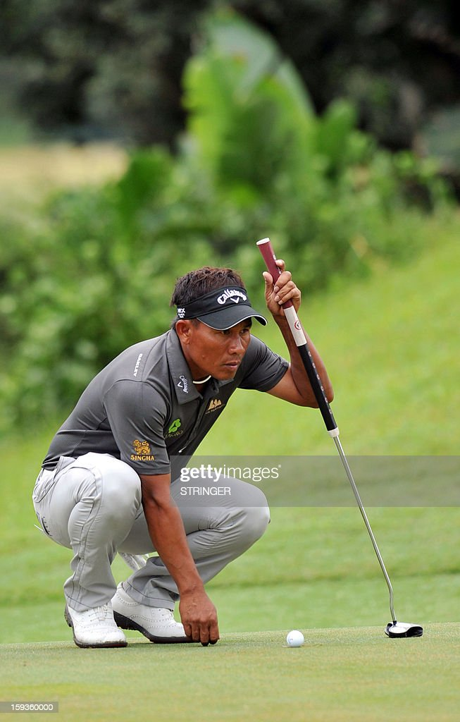 Thongchai Jaidee of Thailand concentrates on Janaury 11, 2013 on the 2nd hole during the second round of the The Volvo Champions in Durban.