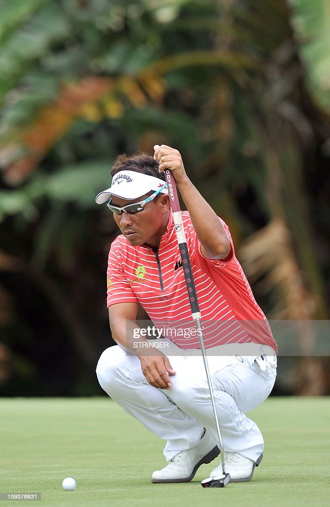 Thongchai Jaidee of Thailand concentrates on the 5th hole during the third round of the The Volvo Champions in Durban on January 12 ,2013. AFP PHOTO / STRINGER