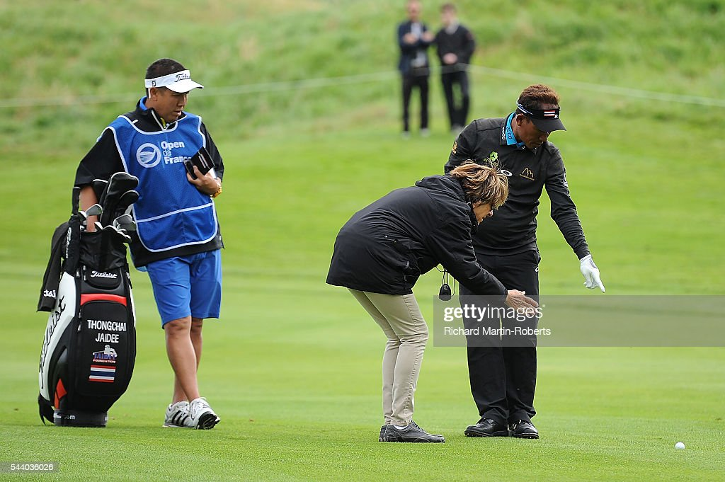 <a gi-track='captionPersonalityLinkClicked' href=/galleries/search?phrase=Thongchai+Jaidee&family=editorial&specificpeople=200733 ng-click='$event.stopPropagation()'>Thongchai Jaidee</a> of Thailand gets a ruling on the 13th hole during the second round of the 100th Open de France at Le Golf National on July 1, 2016 in Paris, France.