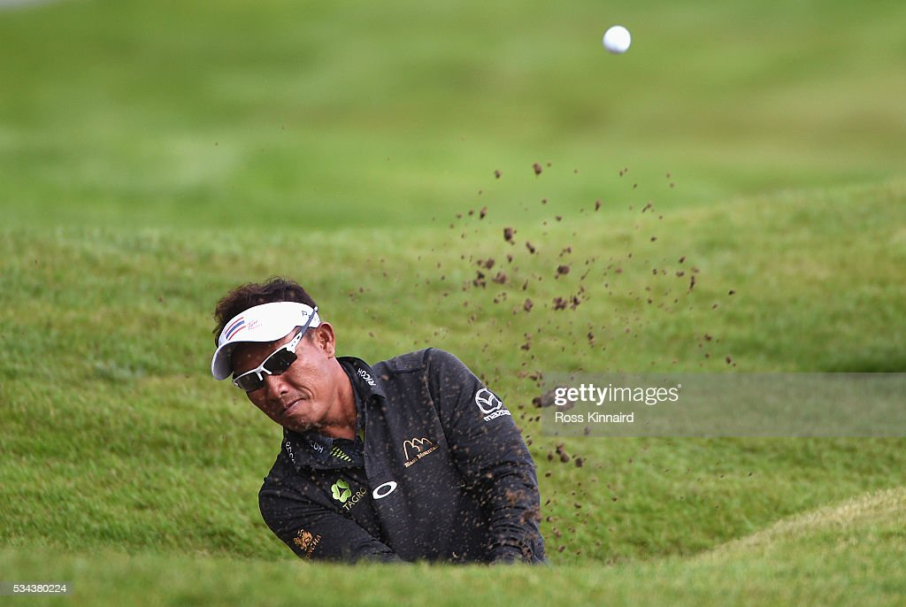 <a gi-track='captionPersonalityLinkClicked' href=/galleries/search?phrase=Thongchai+Jaidee&family=editorial&specificpeople=200733 ng-click='$event.stopPropagation()'>Thongchai Jaidee</a> of Thailand hits from the bunker on the 4th hole during day one of the BMW PGA Championship at Wentworth on May 26, 2016 in Virginia Water, England.
