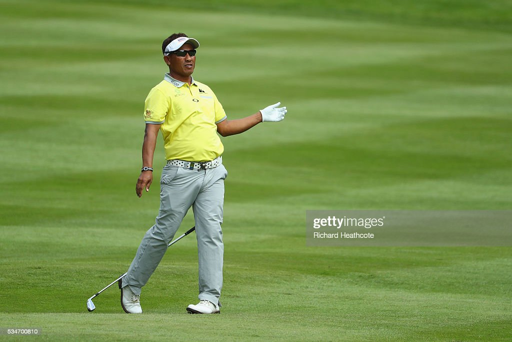 <a gi-track='captionPersonalityLinkClicked' href=/galleries/search?phrase=Thongchai+Jaidee&family=editorial&specificpeople=200733 ng-click='$event.stopPropagation()'>Thongchai Jaidee</a> of Thailand hits his 2nd shot on the 12th hole during day two of the BMW PGA Championship at Wentworth on May 27, 2016 in Virginia Water, England.