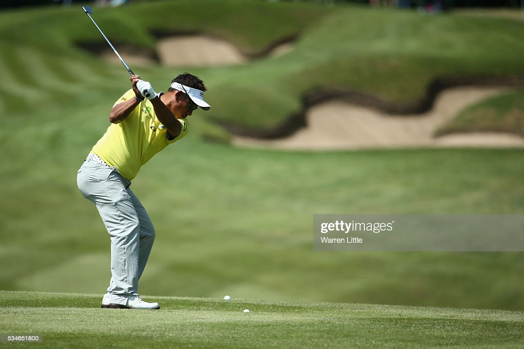 <a gi-track='captionPersonalityLinkClicked' href=/galleries/search?phrase=Thongchai+Jaidee&family=editorial&specificpeople=200733 ng-click='$event.stopPropagation()'>Thongchai Jaidee</a> of Thailand hits his 2nd shot on the 1st hole during day two of the BMW PGA Championship at Wentworth on May 27, 2016 in Virginia Water, England.