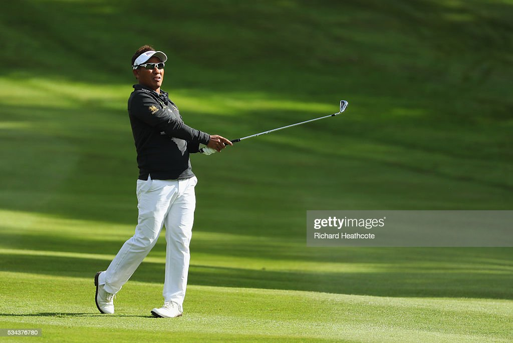 <a gi-track='captionPersonalityLinkClicked' href=/galleries/search?phrase=Thongchai+Jaidee&family=editorial&specificpeople=200733 ng-click='$event.stopPropagation()'>Thongchai Jaidee</a> of Thailand hits his 2nd shot on the 4th hole during day one of the BMW PGA Championship at Wentworth on May 26, 2016 in Virginia Water, England.